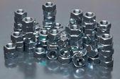 Shiny metal nuts — Zdjęcie stockowe