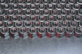 Shiny metal nuts on a metal surface — ストック写真