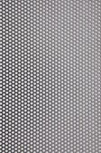 Metal surface with holes — Stock Photo