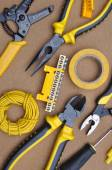 Tools for electrical installation on brown felt — Stock Photo