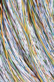 Colored wires in the global telecommunications networks — Stock Photo