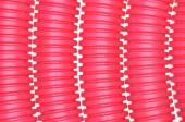 Red plastic corrugated pipe — Stock Photo