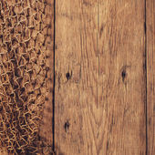 Hanging Fishnet on Wood Wall — Photo