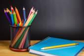 Teacher's desk with a color pencils — Stock fotografie
