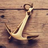 Anchor on wood background — Stock Photo