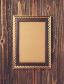 Frame on wood background — Stock Photo