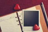 Photo and hearts on Notebook — Stock Photo