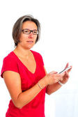 Woman in red t shirt on smartphone in studio — Stock Photo