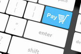 Pay key with shopping cart — Stock Photo