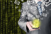 Business man sending emails — 图库照片
