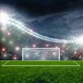 Soccer ball on green stadium arena — Zdjęcie stockowe