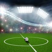 Bola y el centro del campo de fútbol — Foto de Stock