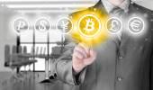 Choosing bitcoins, businessman pressing touch screen button. — Stock Photo