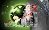 Affärsman ritning en växande graf — Stockfoto