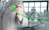 Business man drawing a growing graph — Stock Photo