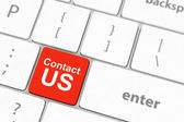 Contact us keyboard button — Стоковое фото
