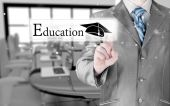 Business man pointing education concept — Stockfoto