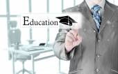 Business man pointing education concept — Stock Photo