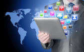 Business man use tablet pc with colorful application icons — Stockfoto