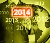 Kaufmann berühren neujahr 2014 — Stockfoto