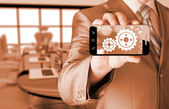 Businessman show gear on smartphone to success concept — Stock Photo