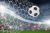 Soccer ball in goal net — Stock Photo