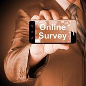 Businessman showing business concept on smartphone  - Online Survey — Photo