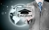Business man pointing education concept — Foto de Stock