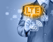 Businessman is pushing his finger on lte button — Stock Photo