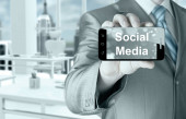 Business man hand holding smartphone with Socail Media — Foto de Stock
