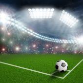 Soccer ball on the green field corner — Stock Photo