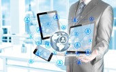 Business man using tablet PC and smartphone social connection — Stockfoto