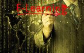 E ラーニングの概念を書くビジネス男 — ストック写真