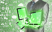 Technology in the hands of businessmen — Stock Photo
