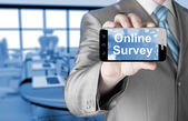 Businessman showing business concept on smartphone  - Online Survey — Stockfoto