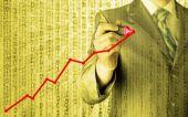Człowiek biznesu rysunek wykres rośnie — Zdjęcie stockowe