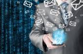 Business man holding smart phone and sending emails — Foto de Stock