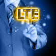 Businessman is pushing his finger on lte button — Zdjęcie stockowe #60164011