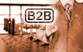 Businessman pointing to word B2B, business-to-busines s, written in the foreground — Stock Photo
