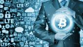 Businessman with protective gesture bitcoins — Stock Photo