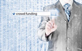 Businessman and crowd funding in search bar — Stock Photo