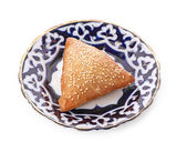 Cooked golden Samosas from low perspective isolated on white. — Stock Photo