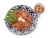 Oriental shah pilaf, pilaw, plov, rice with meat in pastry filo, delicious fragrant spicy dish — Stock Photo