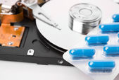 Pills on computer hard drive - concept technology background — Stock Photo