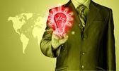 Business man touching light of idea — Stock Photo