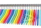 Colorful rainbow coat hangers — Stockfoto