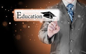 Man pointing education button — Stock Photo