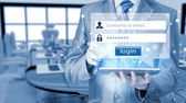 Businessman entering login — Stock Photo