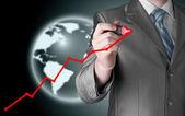 Zakenman tekening van een groeiende grafiek — Stockfoto