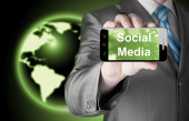 Business man mano smartphone con i media sociali — Foto Stock